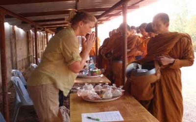 Giving alums to Monks at Tiger Temple